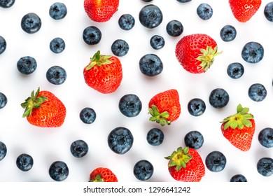 various fresh berries: strawberries and blueberries