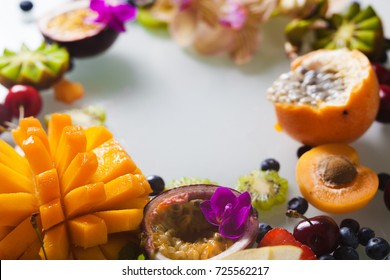 Various fresh fruits and berries with Orchid flower closeup with Orchid flower closeup on white background.