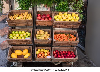 Various  fresh fruits and vegetables on market counter in a  wooden boxes. Street market