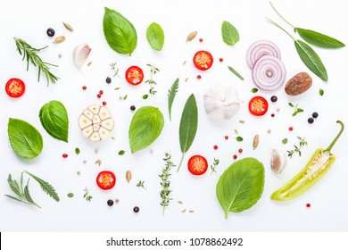 Various fresh herbs for cooking ingrediens peppermint on white wooden background with flat lay .