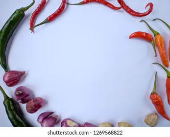 Various fresh herbs on white background. Ingredients for cooking concept chilli, candlenut, garlic and onion with flat lay
