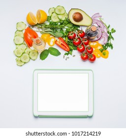Various fresh organic vegetables for tasty summer salad and tablet mock up on white background, top view.  Modern cooking, eating and dieting concept. Blog or online shopping layout
