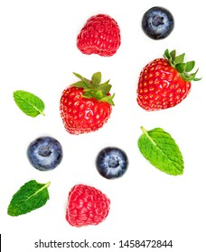 Various fresh summer berries  isolated on white background, top view. Strawberry, Raspberry, Blueberry and Mint leaf, flat lay