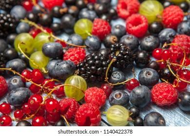 Various fresh summer berries. Top view. Berries mix fruit color food dessert Berries.Antioxidants, detox diet, organic fruits.