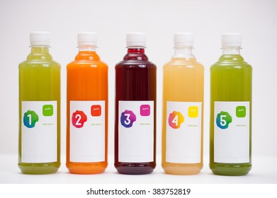 Various fresh vegetable detox juices, colourful smoothies in the bottle on a white background