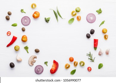 Various fresh vegetables and herbs on white background.Ingredients for cooking concept sweet basil ,tomato ,garlic ,pepper and onion with flat lay.