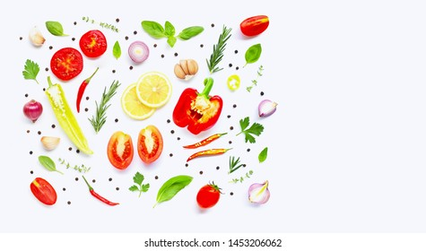Various fresh vegetables and herbs on over white background. Healthy eating concept. Copy space