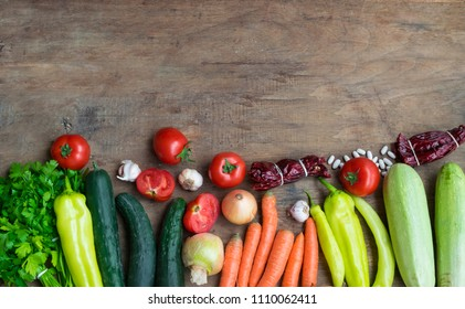 Various fresh vegetables from market on wooden background with space for text. High angle view