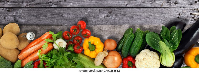 Various fresh vegetables from market on wooden background