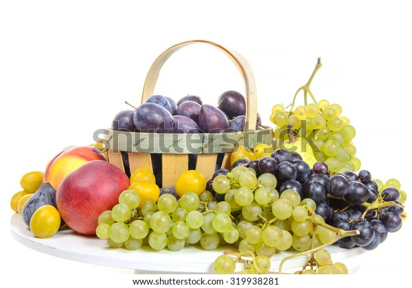 various fruits, grapes, plums, peaches, isolated on white background