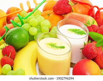 Various fruits and milk shake in glass, closeup.