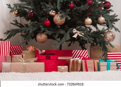 various gifts under beautiful christmas tree