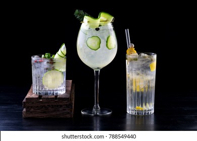 various gin tonic mixed fancy drink cocktail garnish glass plain background