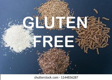 Various gluten-free products: buckwheat, quinoa, einkorn (polba, spelt) pasta and soba (buckwheat flour noodles). On a black background. Top view