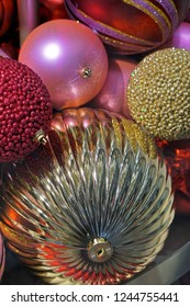 Various gold and pink Christmas baubles decoration