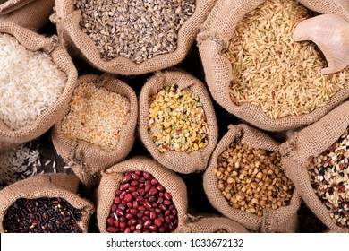 Various grains and cereals in sack on market stall. Top view.