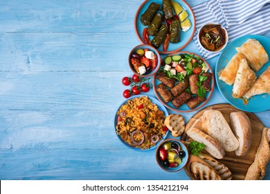 Various Greek dishes on a blue wooden background.Copy space