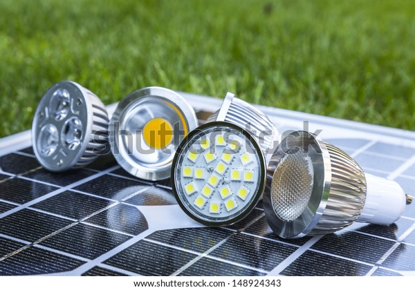 various GU10 LED bulbs on photovoltaics in the grass E27 LED and CFL  bulbs