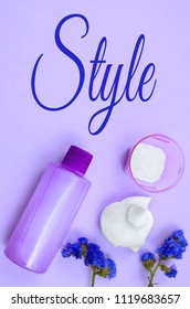 Various hair and body beauty products. Overhead perspective, vertical composition. Text added for style. Ultra violet color palette