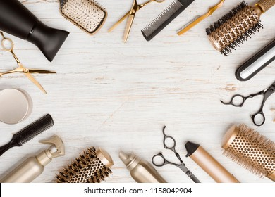 Various hair dresser tools on wooden background with copy space