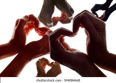 Various hands forming a symbol of love and peace.