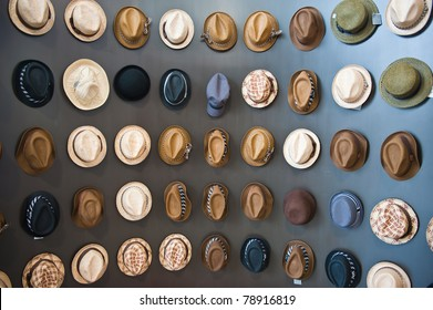 Various hats on wood wall