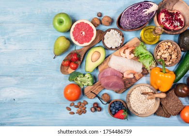Various healthy foods for dash diet on blue wooden background.Flat lay