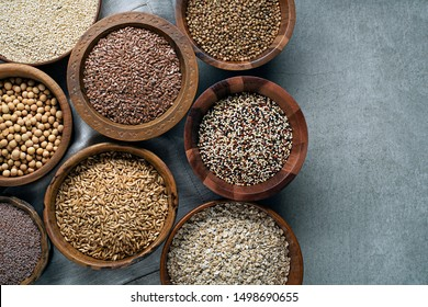 Various of healthy seeds and cereals - sesame, flax seed, chia seeds, soybean, buckwheat, psyllium, wheat and oats. Copy space.