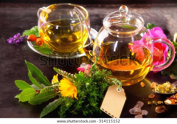 Various Herbal tisane tea with hibiscus and camomille blossom with teapot and teacup