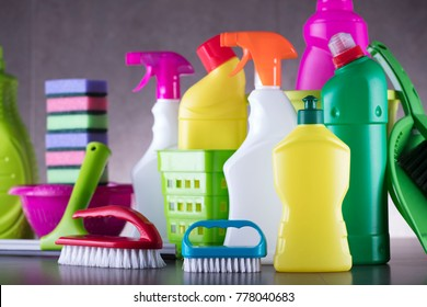 Various house cleaning products. Gray tiles. Place for text.