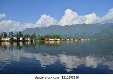 Various houseboats and floating market at Dal Lake in Srinagar look beautiful with their reflection in the clear lake waters. Amidst the pristine Kashmir valley, Dal lake hosts over 500 houseboats