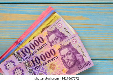 Various Hungarian banknotes on a wooden table, 1-2-5-10 thousand forints. Europe Hungary.