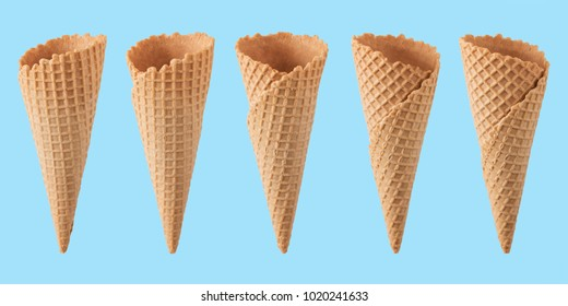 Various ice cream cones isolated on blue background.