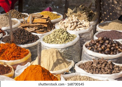 Various of Indian colored powder spices on the flea market in India, Goa.