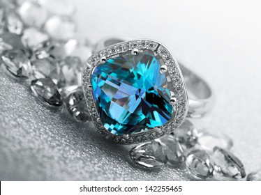 Various Jewelry gem stones on grey background