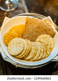 Various kind of Biscuits with many shapes circle and square inside white bowl.