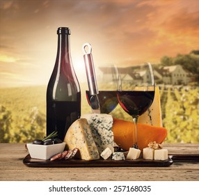 Various kind of cheese with red wine