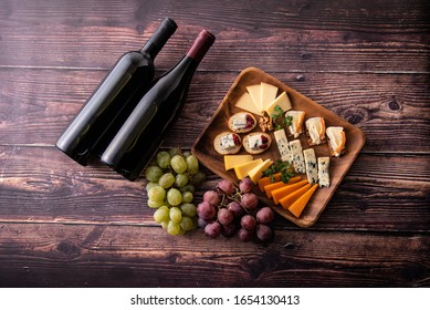 Various kind of fresh cheese with red wine