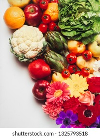 various kind of fruits, flowers and vegetables forming a background