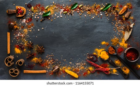 Various kind of Indian spices, Herbs, and condiments on stone background. Top view with copy space