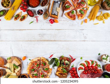Various kind of italian food served on wood. Top view, free space for text