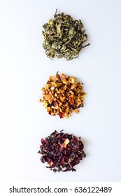 Various kind of leaf tea on a white background, top view