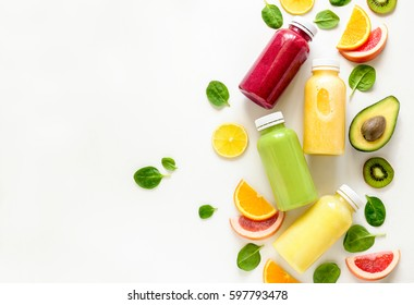 Various kind of smoothies or juices in bottles, healthy diet food concept, view from above, space for a text