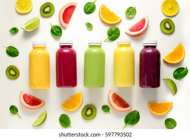 Various kind of smoothies or juices in bottles, healthy diet food concept, view from above