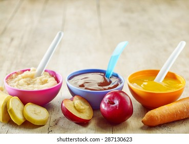 various kinds of baby food in plastic bowls
