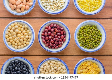 Various kinds of beans,different kinds of beans in bowl on wooden table.Healthy and nutrition food concept.Different dry beans for eating healthy, diet and healthy lifestyle.
