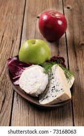 Various kinds of cheese, radicchio and apple