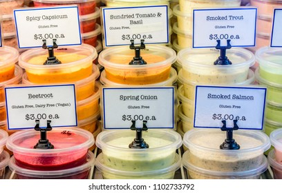 various kinds of dips are stacked up and for sale at the Queen Victoria Market in Melbourne, Australia