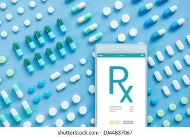 Various kinds of medical pills with Rx sign on smartphone screen , online pharmacy concept