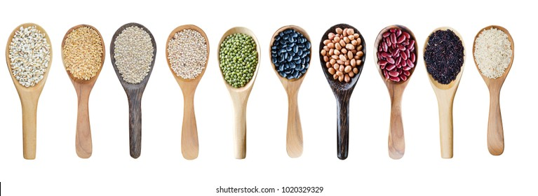 Various kinds of natural grains or cereals consisted of wheat, millet, beans, and rice seeds in wooden spoon isolated on white background, for natural food and agricultural product concept